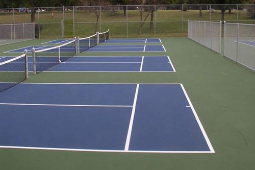 Four stand alone 36' tennis courts for Kids Tennis using the US Open blue/green color scheme!