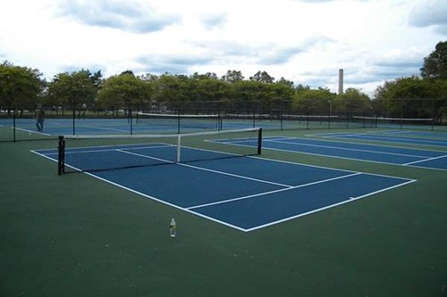 Four stand alone 36' tennis courts next to two 78' tennis courts.