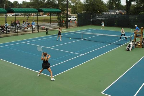 60' blended lines on a 78' tennis court being used for a competitive varsity collegiate tennis match