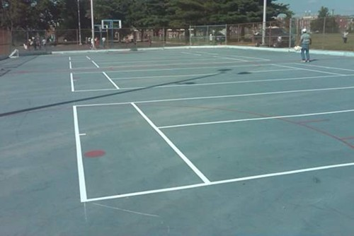 Four 36' tennis courts on a reclaimed outdoor roller hockey rink.