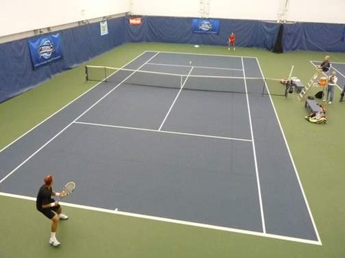 60' blended lines on a 78' indoor tennis court using a dark blue on light blue color scheme at the U