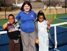 Adrienne Lacy, Community Center Supervisor at City of Fort Worth, with kids at the Southwest Community Center's new 36' courts