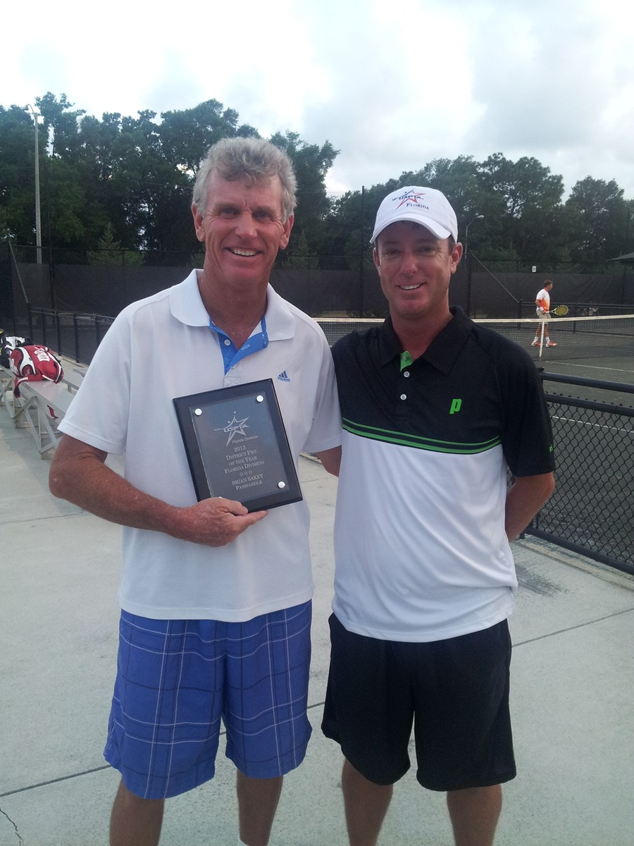 Brregion_1W-ian_Sakey_(left)_receives_the_2013_USPTA_Pro_of_the_Year_Award_from_District_1_President_Michael_Edge
